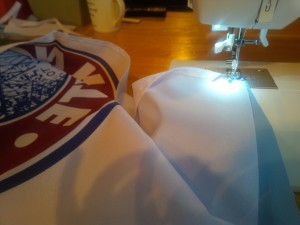 Sewing the fabric and flag together