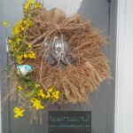 Spring Wreath with burlap, flowers and decorative bird.